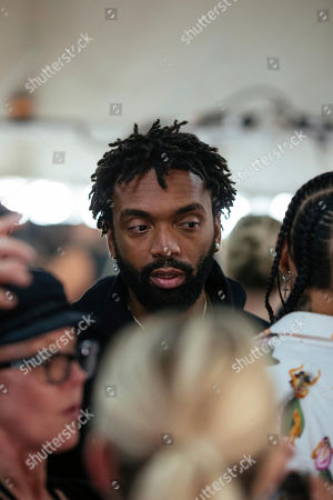 Designer Kerby Jean-Raymond looks in on hair and makeup ahead of the presentation of the Pyer Moss collection during Fashion Week, in New York