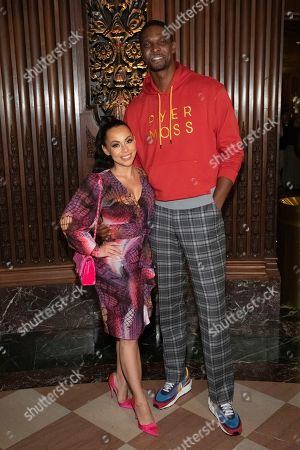 Chris Bosh, guest. Professional basketball player Chris Bosh and a guest attend the Pyer Moss runway show during NYFW Spring/Summer 2020, in Brooklyn, New York