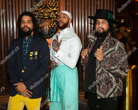 Clayton Griggs, Jidenna, Chris Griggs. Rapper Jidenna, center, poses with designers Clayton Griggs, left, and Chris Griggs at the Pyer Moss runway show during NYFW Spring/Summer 2020, in Brooklyn, New York