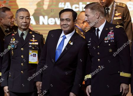 Apirat Kongsompong, Prayuth Chan-ocha, James McConville. Thai army chief Gen. Apirat Kongsompong, left, and Thailand's Prime Minister Prayuth Chan-ocha, center, talk to Chief of staff of the U.S. Army Gen. James McConville during a group photo session at the 11th Indo-Pacific Armies Chiefs Conference and 43rd Indo-Pacific Armies Management Seminar in Bangkok, Thailand, . The events aim to promote peace and stability in the Indo-Pacific region through mutual understanding, dialogue on pressing security challenges in one of the globe's most volatile regions