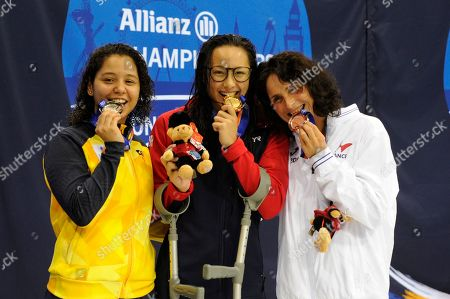 Alice Tai of Great Britain celebrates winning during the Women's 50m Freestyle S8 with Claire Supiot bronze medal winner and silver medal winner JCecilia Jeronimo de Araujo (L) at Day five of the London 2019 World Para Allianz Championships at the London Aquatics centre in Stratford, London, UK - 13th September 2019