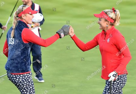 Lexi Thompson and Jessica Korda celebrate on the 18th green after they halved their match