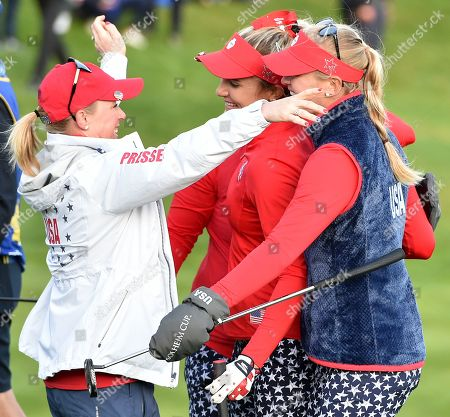 Morgan Pressel of Team USA congratulates Lexi Thompson and Jessica Korda on the 18th green after they halved their match