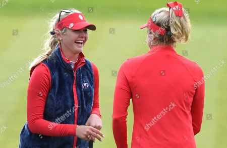 Lexi Thompson of Team USA and Jessica Korda of Team USA celebrate after winning the 10th hole