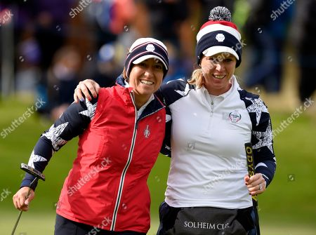 Stock Image of Marina Alex of Team USA celebrates as she holes a putt on the 12th green as her team with Morgan Pressel of Team USA fights back to win against Anne van Dam (Holland) of Team Europe and Anna Nordqvist (Sweden)