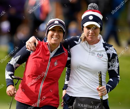Marina Alex of Team USA celebrates as she holes a putt on the 12th green as her team with Morgan Pressel of Team USA fights back to win against Anne van Dam (Holland) of Team Europe and Anna Nordqvist (Sweden)