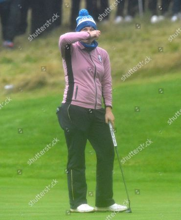 Caroline Masson (Germany) of Team Europe looks dejected after missing a putt on the 18th green to win her match against Lexi Thompson and Marina Alex of Team USA