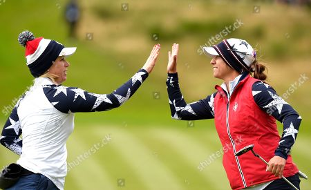 Morgan Pressel of Team USA and Marina Alex celebrate winning the hole as they start a remarkable fight back on the 10th hole as they come from behind to beat Anne van Dam (Holland) of Team Europea and Anna Nordqvist (Sweden)