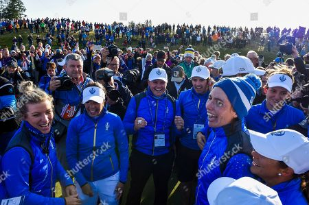 An emotional Carlota Ciganda (Spain) of Team Europe celebrates on the 18th green with Georgia Hall (England) and Anne van Dam (Holland) and Melissa Reid (England) Non-playing assistant captain of Team Europe