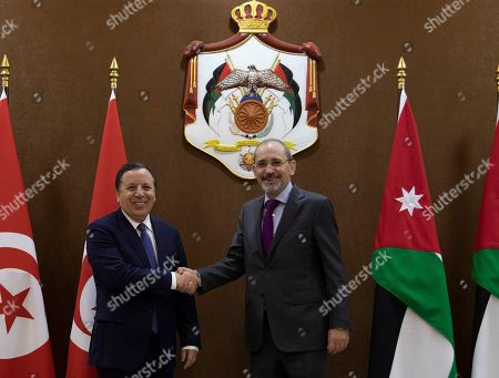 Tunisian Foreign Minister Khemaies Jhinaoui (L) and his Jordanian counterpart Ayman Safadi pose for a photograph at the Foreign Ministry in Amman, Jordan, 09 September 2019.