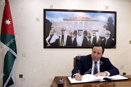 Tunisian Foreign Minister Khemaies Jhinaoui signs the guest book at the Foreign Ministry in Amman, Jordan, 09 September 2019.