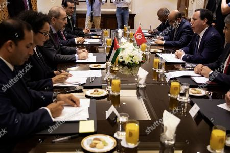 Tunisian Foreign Minister Khemaies Jhinaoui (2-R) speaks with his Jordan counterpart Ayman Safadi (3-R), during a meeting, at the Foreign Ministry in Amman, Jordan, 09 September 2019.