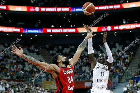 Stock Image of Dennis Schroder of Germany (R) and Khem Birch of Canada in action during the FIBA Basketball World Cup 2019 Classification ?round? match between Germany and Canada in Shanghai, China, 09 September 2019.
