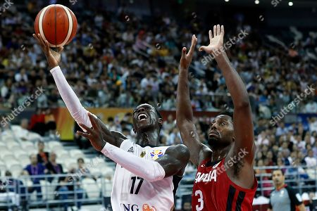 Dennis Schroder of Germany (L) in action against Melvin Ejim of Canada during the FIBA Basketball World Cup 2019 Classification ?round? match between Germany and Canada in Shanghai, China, 09 September 2019.