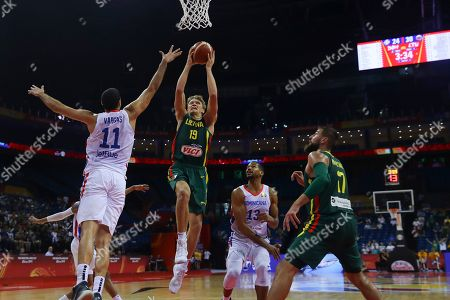 Mindaugas Kuzminskas (2-L) of  Lithuania in action against Eloy Vargas (L) of Dominican Republic during the FIBA Basketball World Cup 2019 match between Dominican Republic and Lithuania in Nanjing, China, 09 September 2019.