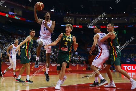 Mindaugas Kuzminskas (3-R) of Lithuania in action against Luis Montero (3-L) of Dominican Republic during the FIBA Basketball World Cup 2019 match between Dominican Republic and Lithuania in Nanjing, China, 09 September 2019.
