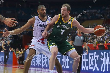Nicolas Batum (L) of France in action against Joe Ingles (R) of Australia during the FIBA Basketball World Cup 2019 classification round group L match between France and Australia in Nanjing, China, 09 September 2019.
