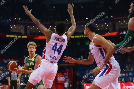 Mindaugas Kuzminskas (L) of Lithuania in action against Luis Montero (2-L) of Dominican Republic during the FIBA Basketball World Cup 2019 match between Dominican Republic and Lithuania in Nanjing, China, 09 September 2019.