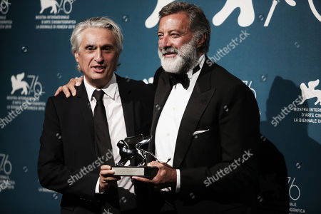 Alain Goldman (L) and Italian Producer Luca Barbareschi (R) hold the Grand Jury Prize for Roman Polanski's movie 'J'Accuse'