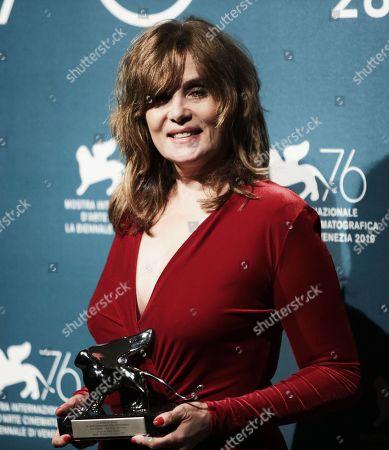 Emmanuelle Seigner holds the Grand Jury Prize for Roman Polanski's movie 'J'Accuse'
