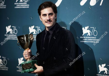 Stock Image of Luca Marinelli holds the Coppa Volpi for Best Actor for his role in the film 'Martin Eden'