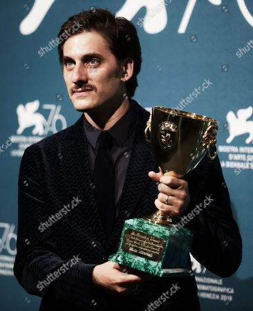 Stock Picture of Luca Marinelli holds the Coppa Volpi for Best Actor for his role in the film 'Martin Eden'