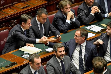 (L-R, back) Italian Premier Giuseppe Conte, Minister of Foreign Affairs Luigi Di Maio, Minister of Culture Dario Franceschini, Minister of Justice Alfonso Bonafede, (L-R front) Minister of Sport Vincenzo Spadafora, Undersecretary Riccardo Fraccaro, Minister for Regional Affairs Francesco Boccia and Minister of Health Roberto Speranza in the Lower House ahead of a confidence vote, in Rome, Italy, 09 September 2019. Conte presented on the day his new government's programme in the Lower House ahead of the first of two confidence votes that the executive is set to face in parliament. His new government is a coalition between the anti-establishment 5-Star Movement (M5S) and the center-left Democratic Party (PD).
