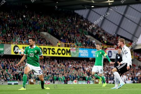 The ball hits the arm of Craig Cathcart of Northern Ireland after Timo Werner of Germany takes a shot at goal