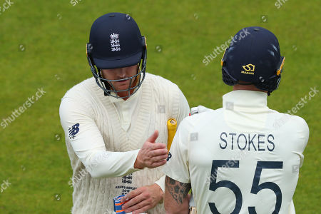 MANCHESTER, ENGLAND. 08 SEPTEMBER Jason Roy and Ben Stokes of England pat each other on the back during day five of the 4th Specsavers Ashes Test Match, at Old Trafford Cricket Ground, Manchester, England