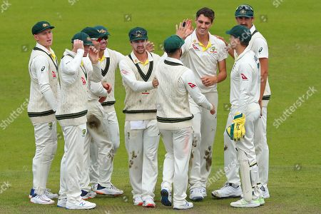 Pat Cummins of Australia celebrates taking the wicket of Jason Roy of England during day five of the 4th Specsavers Ashes Test Match, at Old Trafford Cricket Ground, Manchester, England