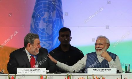 Ralph Gonsalves, Narendra Modi. St. Vincent & the Grenadines' Prime Minister Ralph Gonsalves, left, and his Indian counterpart Narendra Modi share a laugh during the opening ceremony of the 14th Session of the Conference of the Parties (COP14) to United Nations Convention to Combat Desertification in Greater Noida, India