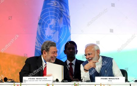 Stock Picture of Narendra Modi, Ralph Gonsalves. St. Vincent & the Grenadines' Prime Minister Ralph Gonsalves, left, and his Indian counterpart Narendra Modi attend the opening ceremony of the 14th Session of the Conference of the Parties (COP14) to United Nations Convention to Combat Desertification in Greater Noida, India
