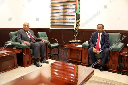 Egyptian Foreign Minister Sameh Shoukry (L) meets with Sudanese Prime Minister Abdalla Hamdok (R) in Khartoum, Sudan, 09 September 2019. Shoukry arrived in Sudan one day after the new government of Prime Minister Abdalla Hamdok was sworn-in, becoming the first cabinet since the ousting of former president Omar Bashir.