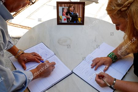 People sign condolence books as they pay their respects to late Spanish singer Camilo Sesto at his funeral chapel installed at the Spanish Society of Authors and Publishers (SGAE) in Madrid, Spain, 09 September 2019. Camilo Sesto died from a cardiac arrest at a clinic in Madrid in the early hours of 08 September 2019 at the age of 72.