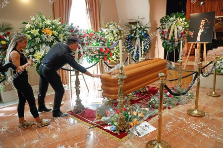 People pay their respects at the coffin of late Spanish singer Camilo Sesto at his funeral chapel installed at the Spanish Society of Authors and Publishers (SGAE) in Madrid, Spain, 09 September 2019. Camilo Sesto died from a cardiac arrest at a clinic in Madrid in the early hours of 08 September 2019 at the age of 72.