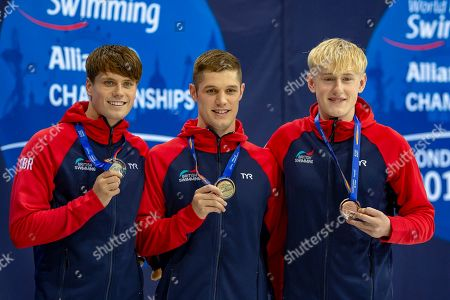 Thomas Hamer of Great Britain (left-Silver), Reece Dunn of Great Britain (centre-Gold), and Jordan Catchpole of Great Britain (right-Bronze) with their medals after the Men's 200 m Freestyle S14 during the World Para Swimming Championships 2019 Day 1 held at London Aquatics Centre, London
