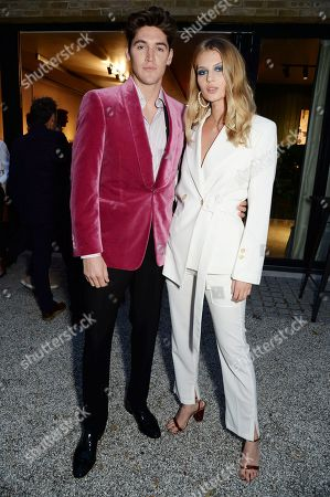 Stock Photo of Isaac Carew wearing Pink Shirtmaker and Florence Kosky