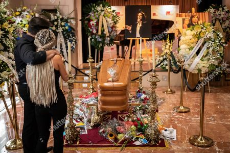 Well wishers pass by the coffin of Spanish singer and songwriter Camilo Sesto in Madrid, . Spanish singer and songwriter Camilo Sesto, a popular star in the 1970s and 1980s, died on Sunday Sept. 8, of heart failure. Sesto, whose real name was Camilo Blanes Cortes, sold more than 100 million records worldwide over his 40-year career
