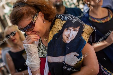Mourners queue to see the coffin of late Spanish singer and songwriter Camilo Sesto in Madrid, . Sesto, whose real name was Camilo Blanes Cortes, sold more than 100 million records worldwide over his 40-year career
