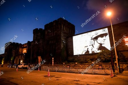 """A guest film by Dee Hibbert-Jones and Nomi Talisman, titled """"Last Day of Freedom"""" is projected on the wall of Eastern State Penitentiary in Philadelphia. The art exhibit at the former prison-turned-museum in Philadelphia is showcasing animated short films created by guests and currently incarcerated inmates in a new exhibit titled """"Hidden Lives Illuminated"""