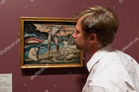 """Satan Smiting Job with Sore Boils"", c. 1826, by British artist William Blake (1757-1827) is pictured during a photocall to promote the upcoming exhibition at the Tate in London."