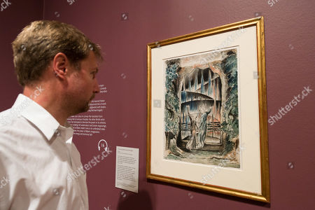 "A gallery staff member views ""The Inscription over the Gate"" (1824-1827) by British artist William Blake (1757-1827) during a photocall to promote the upcoming exhibition at the Tate Britain in London, England."