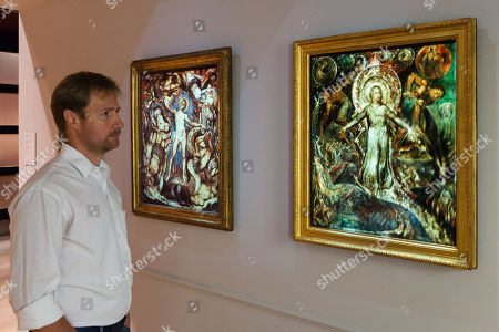 "Stock Photo of (L-R) A gallery staff member views ""The Spiritual Form of Nelson Guiding Leviathan"" (c. 1805-9) and ""The Spiritual Form of Pitt Guiding Behemoth"", 1805, by British artist William Blake (1757-1827) during a photocall to promote the upcoming exhibition at the Tate Britain in London, England."