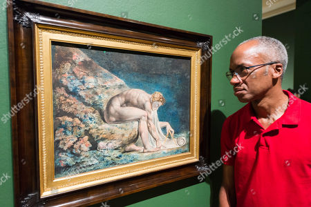 """Stock Photo of A gallery staff member views """"Newton"""" (1795?c.1805) by British artist William Blake (1757-1827) during a photocall to promote the upcoming exhibition at the Tate Britain in London."""