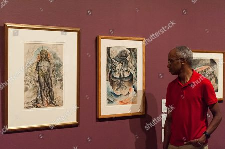 "Stock Picture of (L-R) ""The Symbolic Figure of the Course of Human History described by Virgil"" (1824-1827) and ""The Simoniac Pope"" (1824-1827) by British artist William Blake (1757-1827) are pictured during a photocall to promote the upcoming exhibition at the Tate Britain in London."