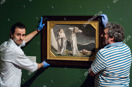 "Gallery staff members install ""Lamech and his Two Wives"", 1795, by British artist William Blake (1757-1827) during a photocall to promote the upcoming exhibition at the Tate Britain in London, England."