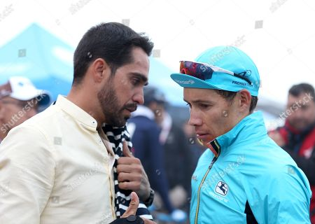 Spanish former cyclist Alberto Contador (L) speaks to Colombian rider Miguel Angel Lopez (R) of team Astana after the 16th stage of the Vuelta a Espana cycling tour, over 144.4km from Pravia to Lena, in northern Spain, 09 September 2019.