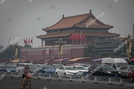 Cars drive on the road in front of the Chairman Mao portrait on the south gate of the Forbidden City, next to the Tiananmen Square, where the big military parade will be held on 01 October, in Beijing, China, 09 September 2019. With increasing of its security measures, where more patrolling policemen on the streets can be spotted, closing bars, and scanning every delivery packages Beijing is preparing weeks in advance for the celebrating of 70th anniversary of People's Republic of China with a huge military parade at Tiananmen Square on 01 October 2019.