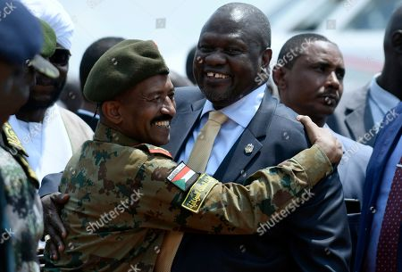 Dr. Riek Machar, center right, greets Sudanese military officer and politicians upon arriving in Juba, Monday, Sept.9, 2019, for face to face talks with South Sudan President Salva Kiir. These talks will be crucial before the November deadline of the formation of the Revitalized Transitional Government of National Unity