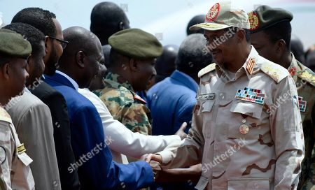 "Sudanese Deputy leader of the forces of the Sudan Transitional Military Council Mohamed Hamdan ""Hemeti"", right, greets Sudanese and South Sudanese military officers and politicians upon arriving in Juba. South Sudan under the leadership of President Salva Kiir is mediating talks between Sudanese opposition parties in Juba, South Sudan"